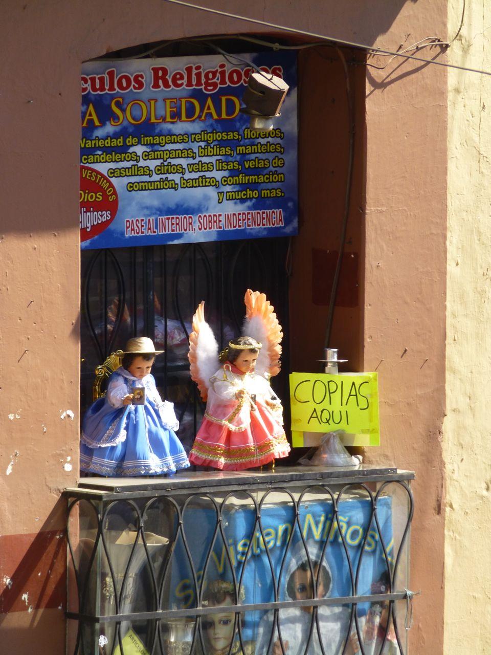 2 Niño Dios in window of store
