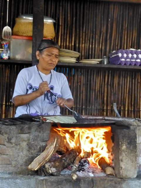 Woman cooking on comal