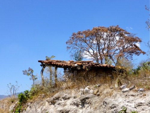 Tile roof lean-to on rocky outcrop