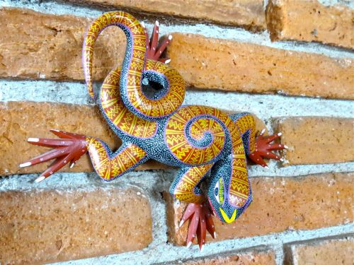 Wood carved and intricately painted lizard