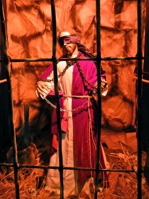 Blindfolded Jesus behind bars