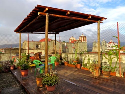 Lamina & wood shade structure on wooden deck