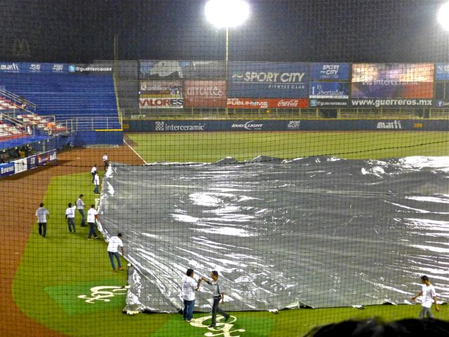 Silver tarp pulled over infield