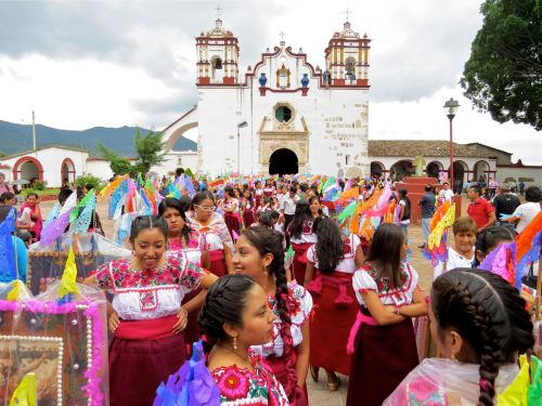 Young Zapotec women and girls in front of church