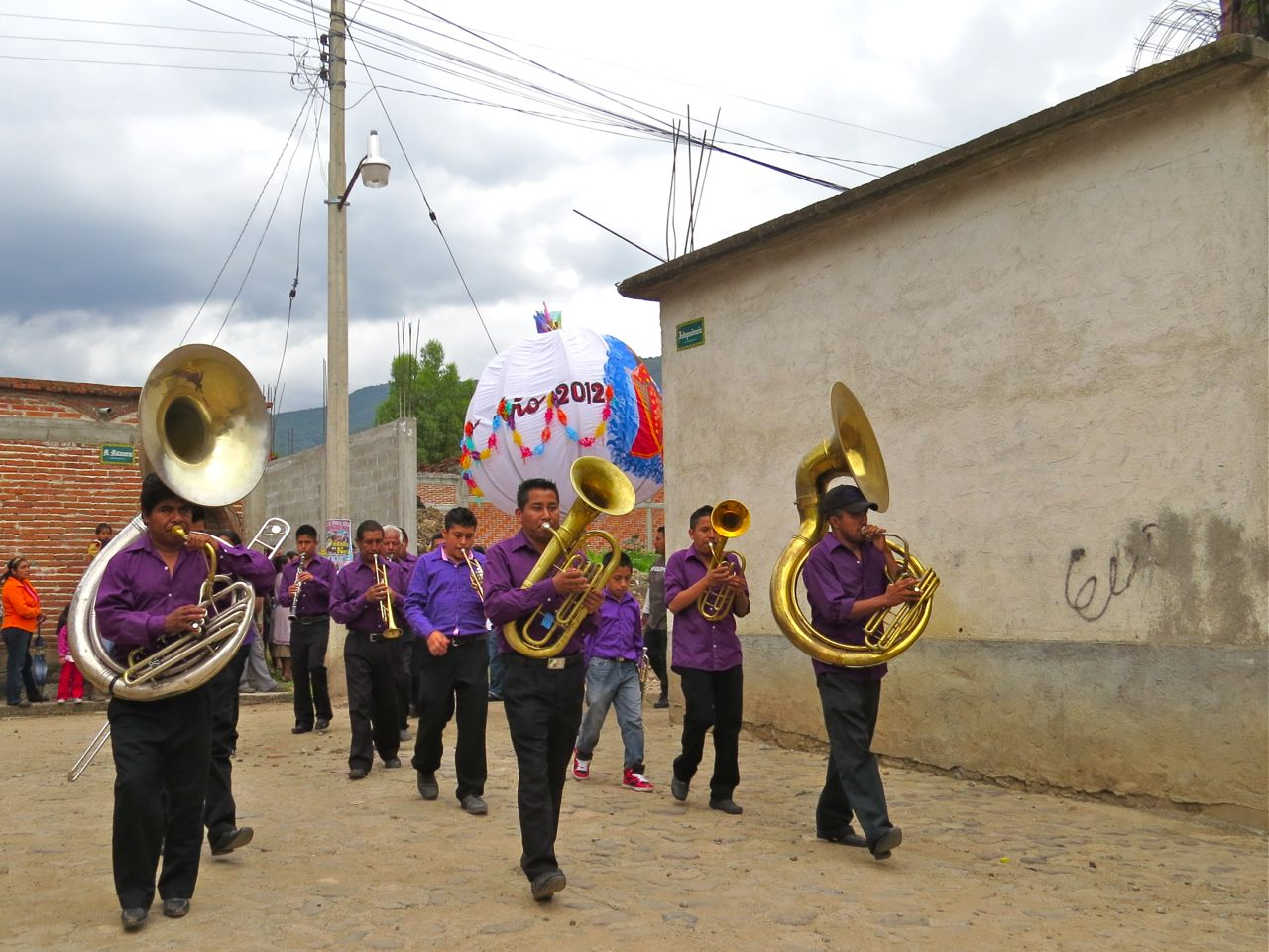 Banda marching down street