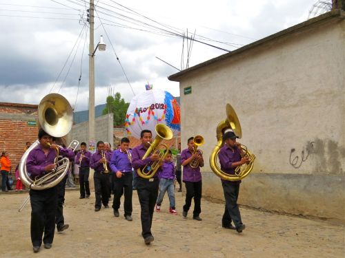 Banda marching down street