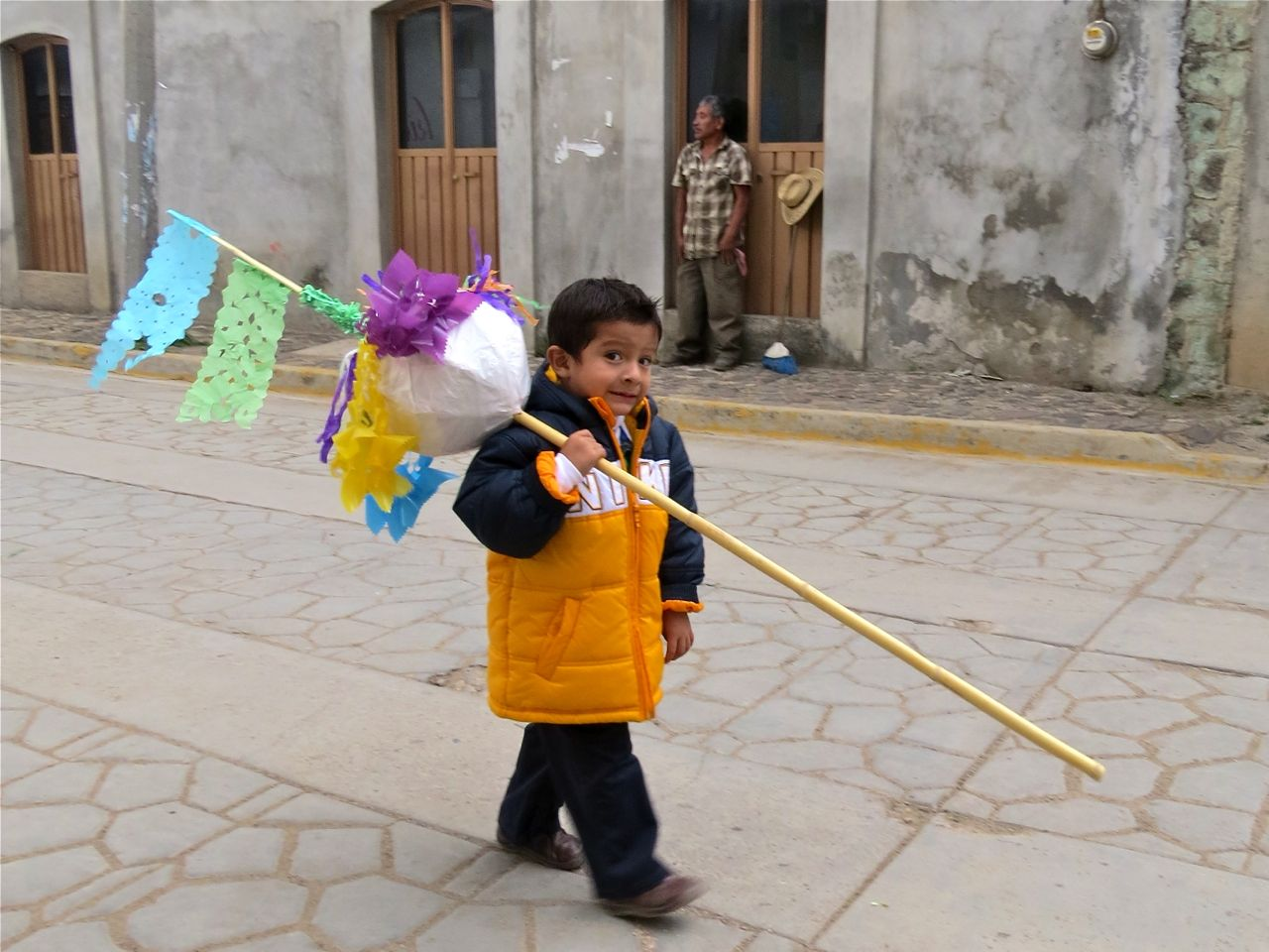Little boy carrying small marmota