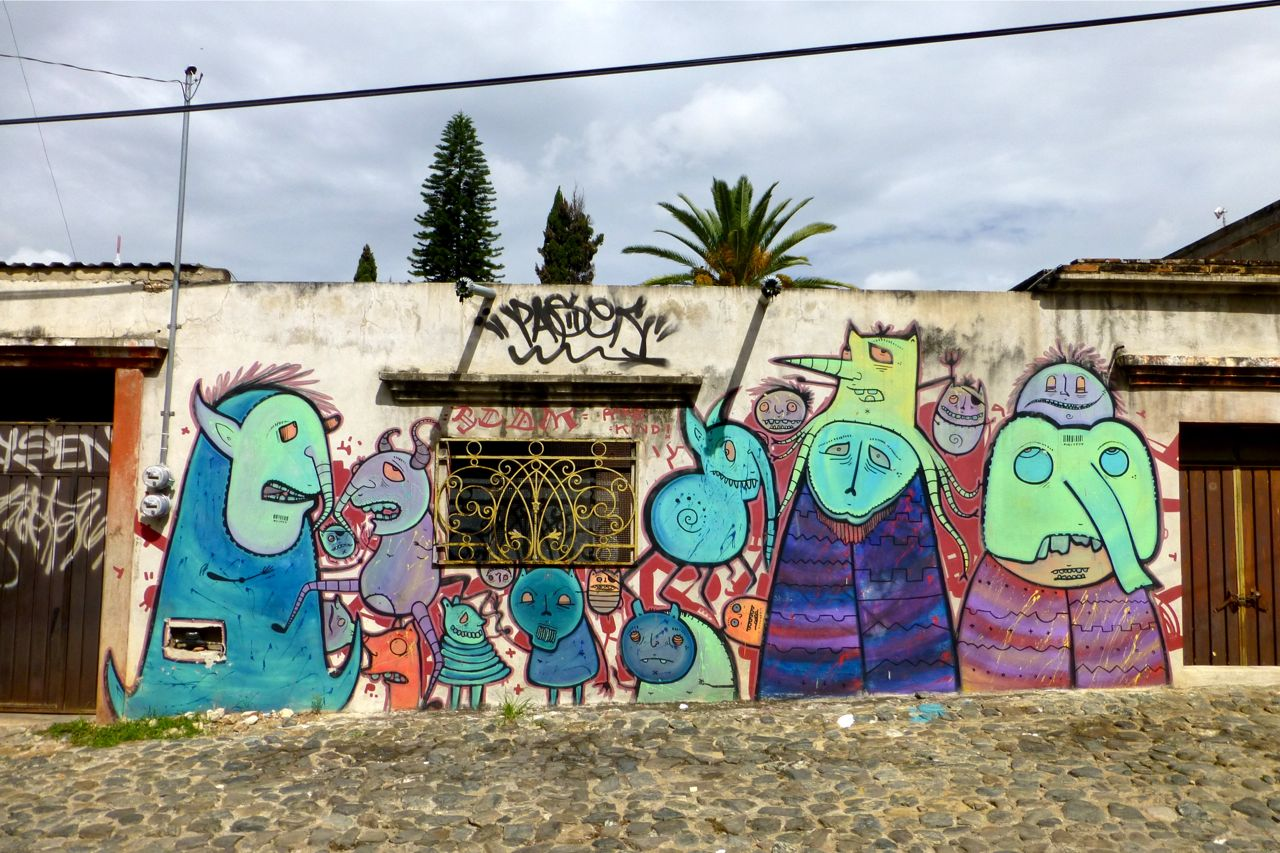 Mural of creatures painted by SCOM on wall