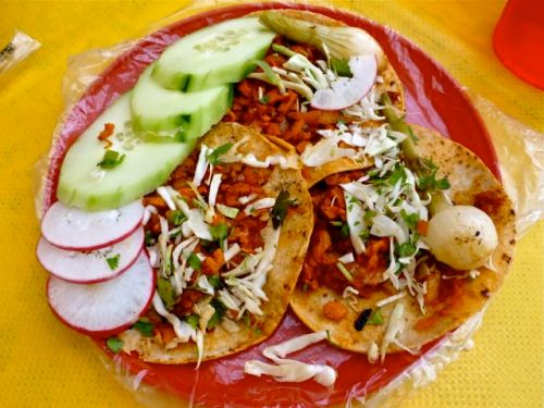 Tacos with roasted onions and chopped pork