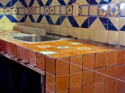 Russet orange tile on counter