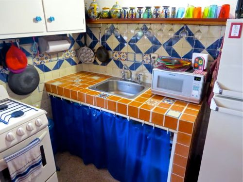 Russet orange tile counter with accent tiles.