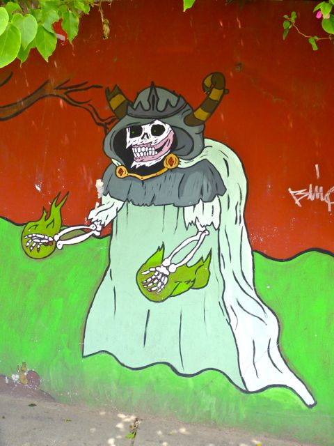 Skeleton in robes painted on wall