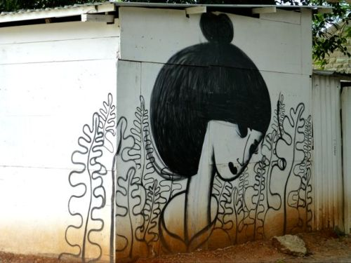Tranquil female face painted on side of building