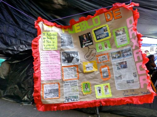 Banner with news clippings, photos, and informational notes