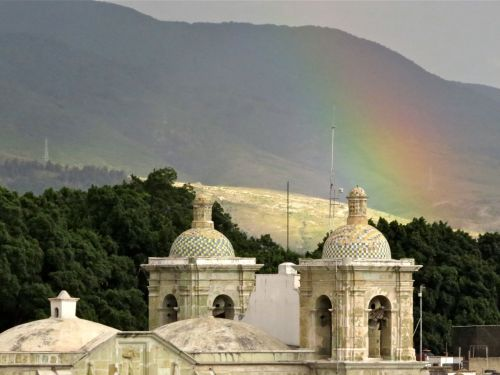 Rainbow over bell towers of San Felipe Neri