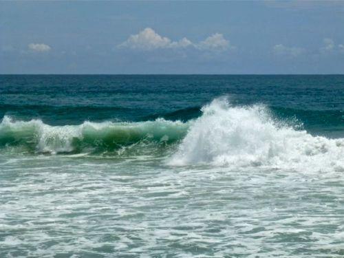 Pacific Ocean waves crashing onto the beach San Agustinillo, Oaxaca.