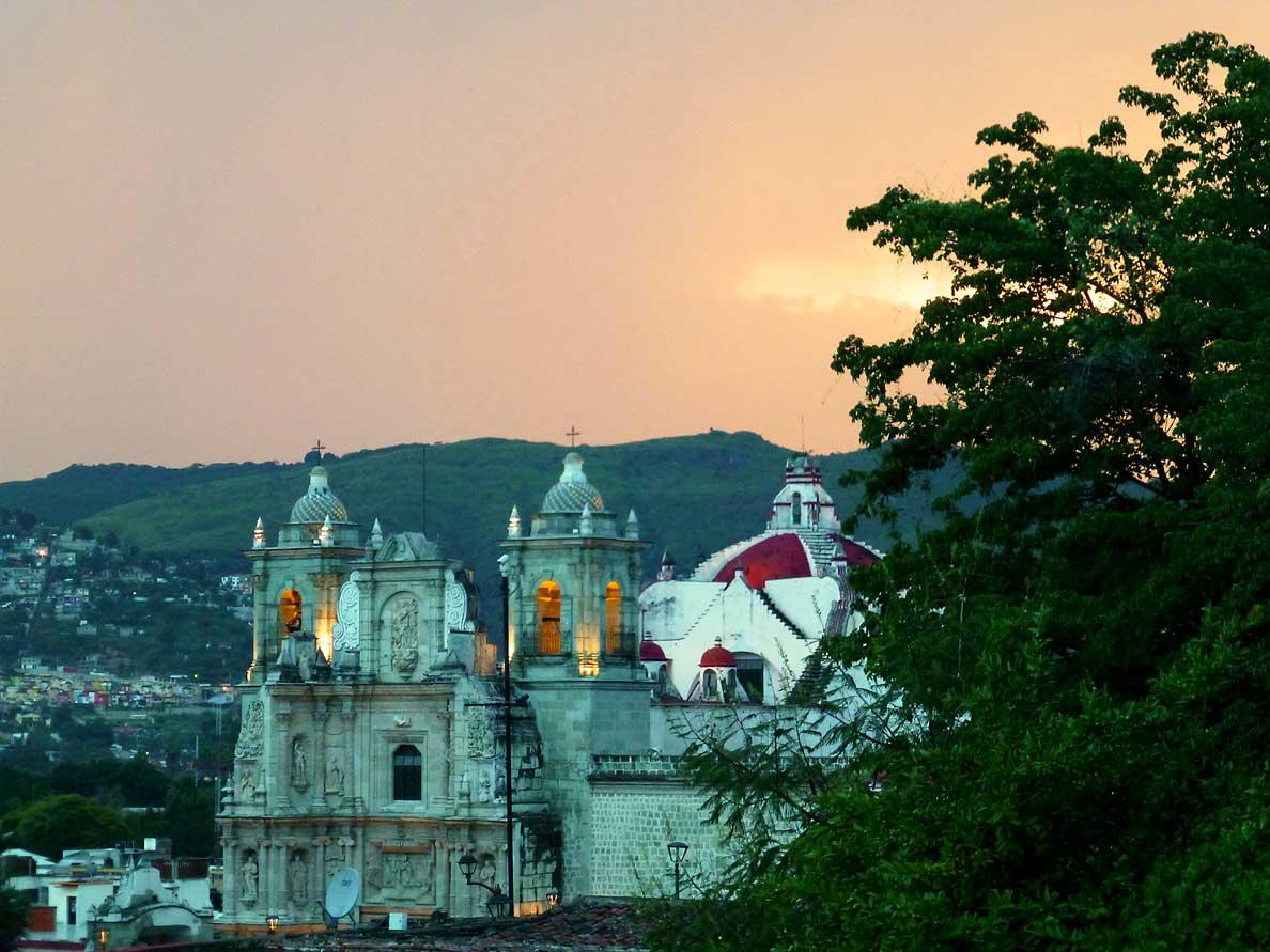 Basílica de La Soledad with red-gray sky