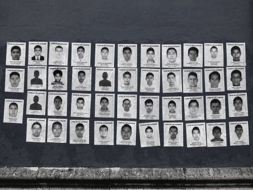 Photos of the 43 students pasted on wall
