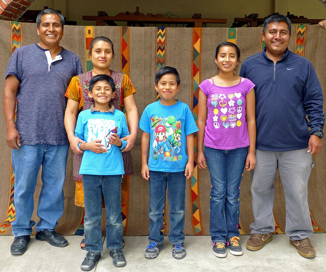 Antonio Ruiz Glz. and family standing in front of rug