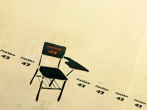 Street art: tilted chair with words