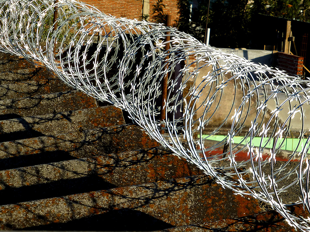 Coiled razor wire on roof