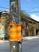 Sign on telephone pole on Crespo