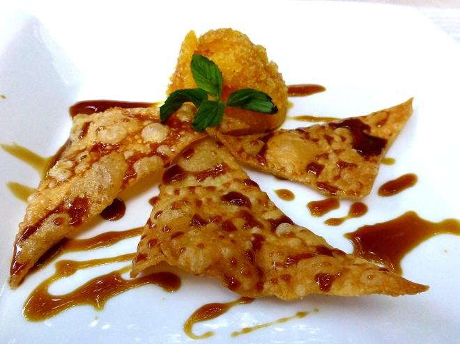 Helado de maracuya con buñelos con miel de piloncillo (Maracuya sorbet with buñuelos drizzled with melted piloncillo, which is similar to brown sugar)