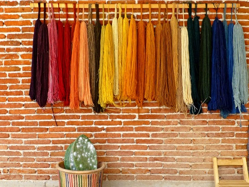 Array of some of their brilliantly colored naturally dyed yarns.