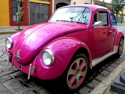 Fuschia vocho parked on street