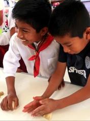 Boys in Villa Díaz Ordaz learning to make Pan de Muertos dough - October 29, 2017