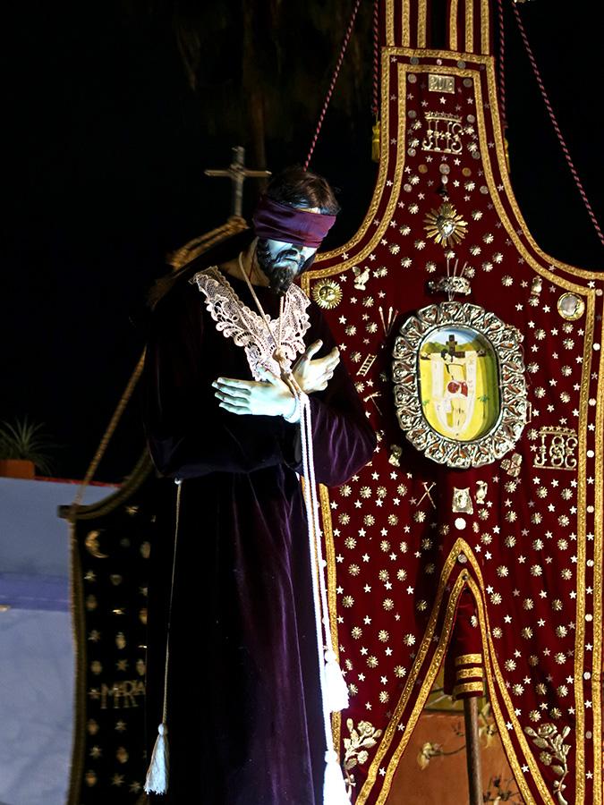 Blindfolded Jesus and banner