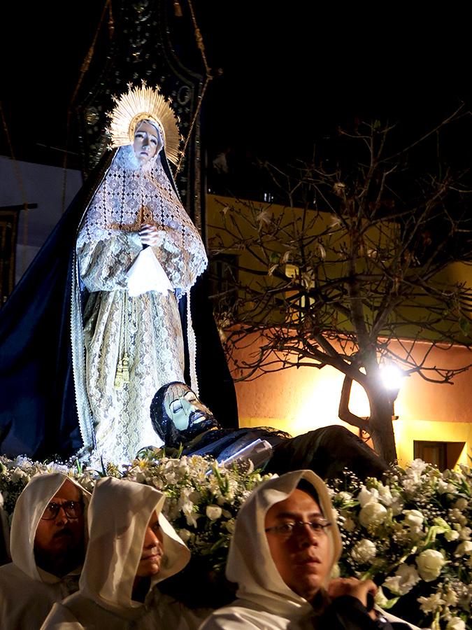 Virgen de los Dolores standing above prone Jesus images