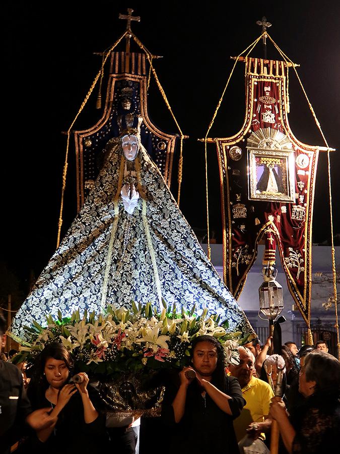 Virgen de la Soledad image carried by women
