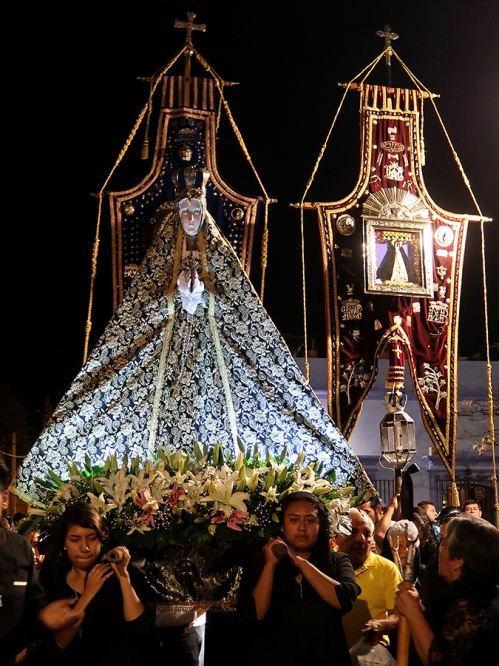 Virgen de la Soledad image carried by women