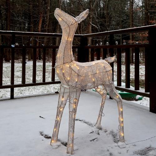 Lighted reindeer in snow